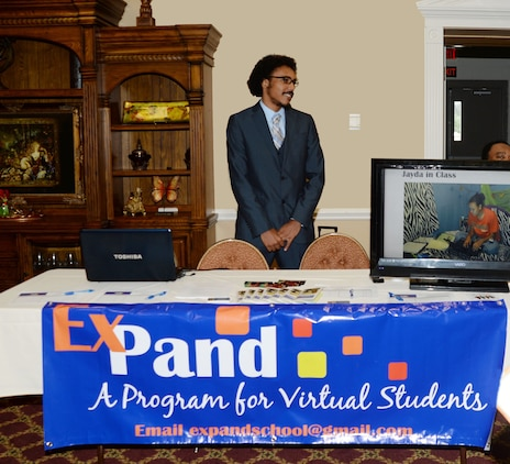 James Robinson III, mentor/tutor, ExPand Program, discusses the overview of some of the benefits and advantages of the Dual Enrollment/Dual Credit and virtual/online programs during the Tools for Schools event at Marine Corps Logistics Base Albany's Town and Country Grand Ballroom, recently. Robinson's sister, Jayda, graduated from college, at the age of 17, with an associate's degree while still in high school. She recently graduated from Florida State University, Tallahassee, Florida, with a Bachelor of Science degree at age 19.