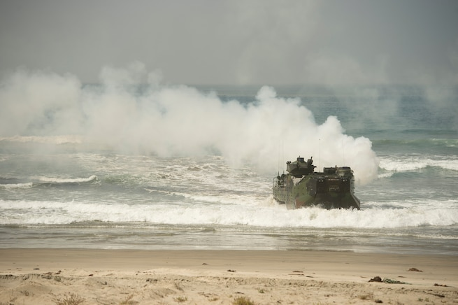 A Marine Corps assault amphibious vehicle participates in a beach assault demonstration as Defense Secretary Ash Carter watches during a visit on Camp Pendleton Calif., Aug. 27, 2015. DoD photo by U.S. Air Force Master Sgt. Adrian Cadiz