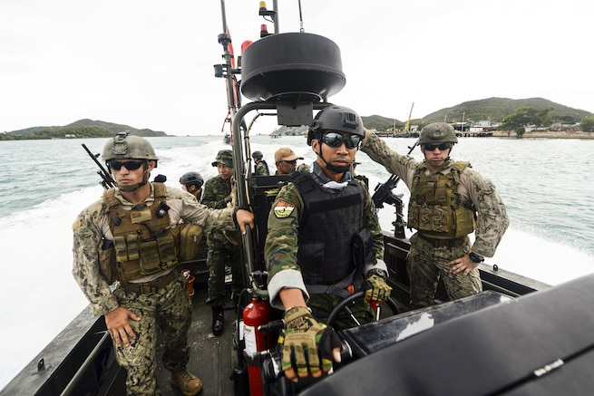 U.S. sailors and members of the Thai navy's riverine patrol regiment train on a special operations craft during Cooperation Afloat Readiness and Training Thailand 2015 in Sattahip, Thailand, Aug. 27, 2015. The U.S. sailors are assigned to Coastal Riverine Squadron 4. In its 21st year, the annual exercise includes the U.S. Navy, U.S. Marine Corps and the armed forces of nine partner nations. U.S. Navy photo by Petty Officer 1st Class Joshua Scott