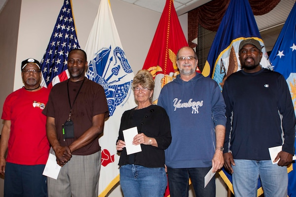 Six DLA Distribution Susquehanna employees are honored for their acts of selfless service and response to a co-worker in distress, including (left to right) Byron Davis, William Taylor, Penny Duprey, Donald Maurice and Regis Hill (not pictured is Joelaniel Borrero-Sanchez).