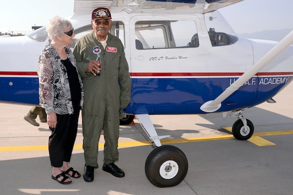 Franklin Macon, a Tuskegee Airman, stands with his girlfriend Amy Lee, on the U.S. Air Force Academy airfield in Colorado, Aug. 25, 2015. Macon had just taken a flight with Cadet 1st Class Scott Lafferty in one of the cadet flying team's T-41s. (U.S. Air Force photo/Mike Kaplan)