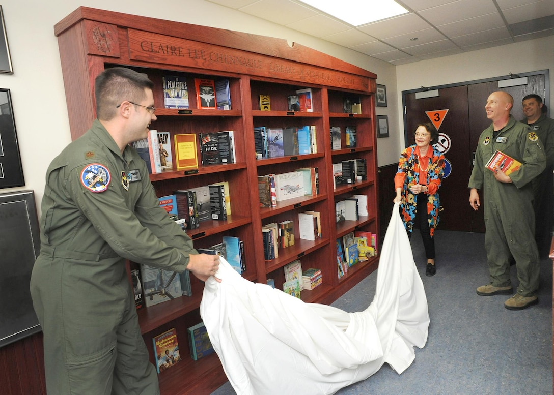Maj. Timothy Manning, 435th Fighter Training Squadron instructor pilot, and Cynthia Chennault, University of Florida-Gainesville professor of Chinese, unveils a library in honor of Lt. Gen. Claire Chennault, commander of the  first  American volunteer group in China during the early years of World War II, better known as the Flying Tigers.  (U.S. Air Force photo by Melissa Peterson/released)