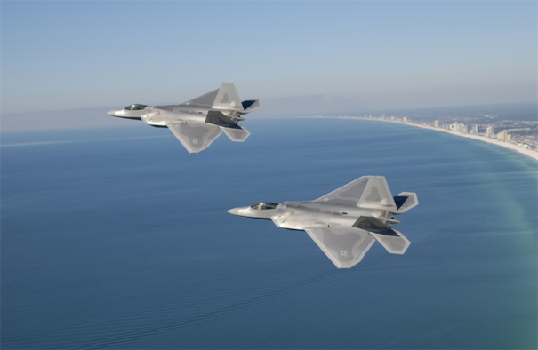 A pair of F-22 Raptors fly near the coastline of Panama City Beach, Fla. (Courtesy photo)