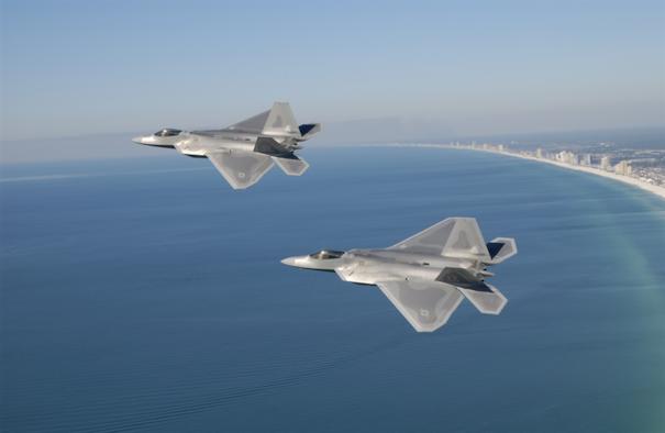 A pair of F-22 Raptors fly near the coastline of Panama City Beach, Fla. (Courtesy photo)