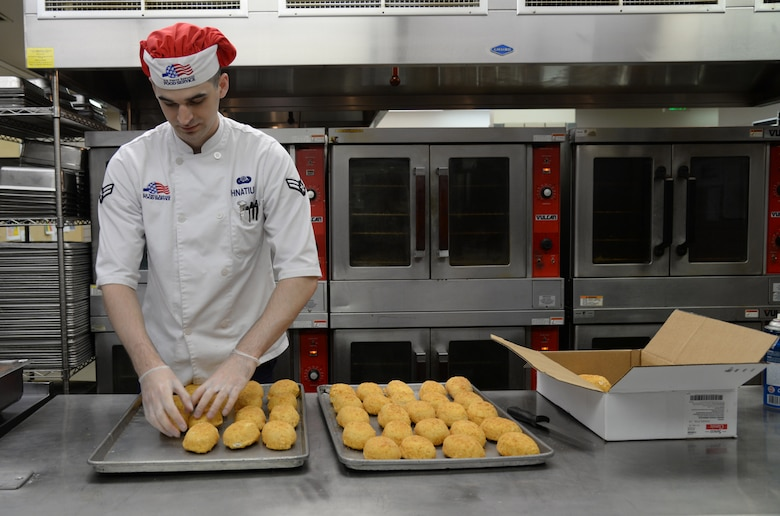 U.S. Air Force Airman 1st Class Jeremy P. Hnatiuk, a 354th Force Support Squadron shift leader, prepares chicken to be cooked in the Two Seasons Dining Facility, Aug. 27, 2015, at Eielson Air Force Base, Alaska. Hnatiuk prepares food on a daily basis to serve to Airmen for breakfast, lunch and dinner. (U.S. Air Force photo by Airman 1st Class Cassandra Whitman/Released)