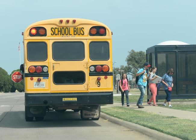 ALTUS AIR FORCE BASE, Okla. – Children get off the Altus Public Schools' bus in base housing, Aug. 28, 2015. The localschool year begain Aug. 11 and parents are encouraged to talk to their children about ways to stay safe as the school year progesses.