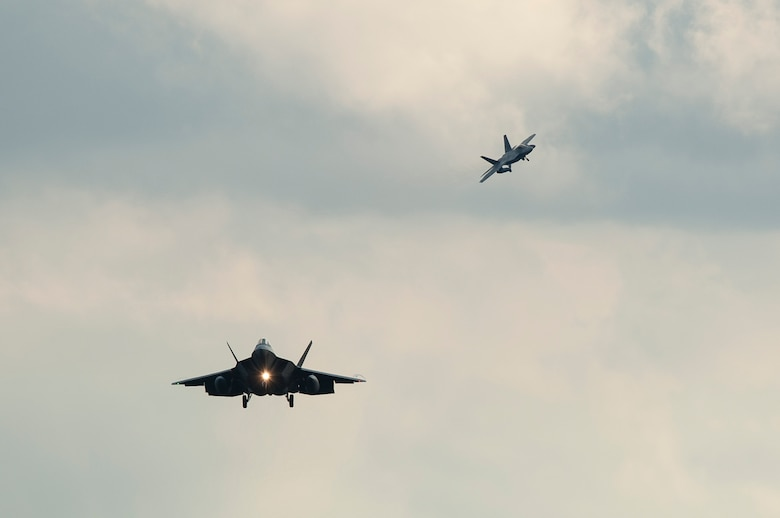 Two F-22 Raptor fighter aircraft prepare to land at Spangdahlem Air Base, Germany, Aug. 28, 2015 as part of the inaugural F-22 training deployment to Europe. Four F-22s from the 95th Fighter Squadron at Tyndall Air Force Base, Fla., along with a C-17 Globemaster III cargo aircraft and more than 50 support Airmen were part of the deployment. This effort is part of the European Reassurance Initiative and will serve to assure allies of the Air Force's commitment to European security and stability. (U.S. Air Force photo by Staff Sgt. Chad Warren/Released)