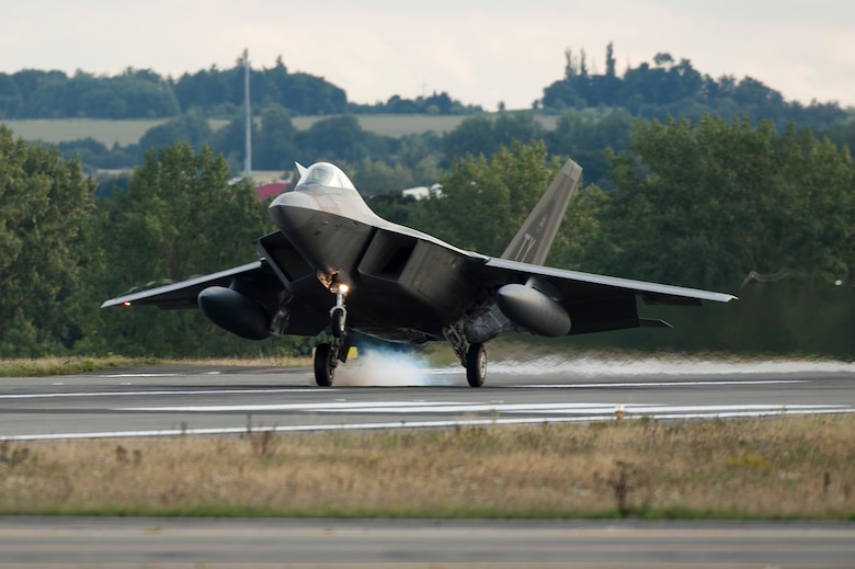 An F-22 Raptor fighter aircraft lands at Spangdahlem Air Base, Germany, Aug. 28, 2015 as part of the inaugural F-22 training deployment to Europe. The F-22s are deployed from the 95th Fighter Squadron at Tyndall Air Force Base, Fla., as part of the European Reassurance Initiative and will conduct air training with other Europe-based aircraft while demonstrating U.S. commitment to NATO allies and the security of Europe. (U.S. Air Force photo by Staff Sgt. Chad Warren/Released)