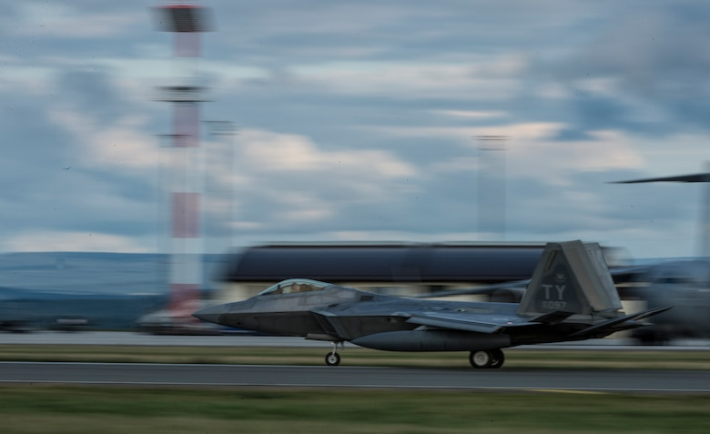 A U.S. Air Force F-22 Raptor fighter aircraft pilot assigned to the 95th Fighter Squadron at Tyndall Air Force Base, Fla., lands on the runway Aug. 28, 2015, at Spangdahlem Air Base, Germany. The U.S. Air Force deployed four F-22 Raptors, one C-17 Globemaster III, and approximately 60 Airmen and associated equipment to Spangdahlem, to train with NATO allies and partners. These relationships are critical to ensuring safety, and stability in the European region. The forward presence allows the rotation of units from the U.S. to augment the forces in Europe whenever needed. (U.S. Air Force photo by Staff Sgt. Christopher Ruano/Released)