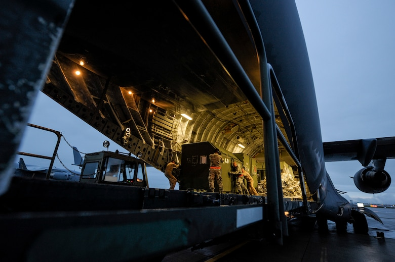 Airmen unload cargo from a U.S. Air Force C-17 Globemaster III from Charleston Air Force Base,  S.C., after arriving at Spangdahlem Air Base, Germany, to support the first ever F-22 Raptor European training deployment Aug. 28, 2015. A single C-17 can deliver nearly 85 tons of cargo to both prepared and unprepared airfields. (U.S. Air Force photo by Senior Airman Rusty Frank/Released)