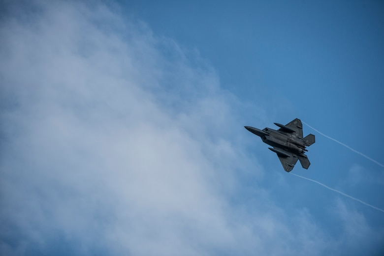 A U.S. Air Force F-22 Raptor fighter aircraft pilot assigned to the 95th Fighter Squadron at Tyndall Air Force Base, Fla., soars over Spangdahlem Air Base, Germany, Aug. 28, 2015. This is the first training deployment of the F-22 Raptor in the U.S. European Command theater. The U.S. Air Force deployed four F-22 Raptors, one C-17 Globemaster III, and approximately 60 Airmen and associated equipment to Spangdahlem, to train with NATO allies and partners. These relationships are critical to ensuring safety, and stability in the European region. The forward presence allows the rotation of units from the U.S. to augment the forces in Europe whenever needed. (U.S. Air Force photo by Staff Sgt. Christopher Ruano/Released)