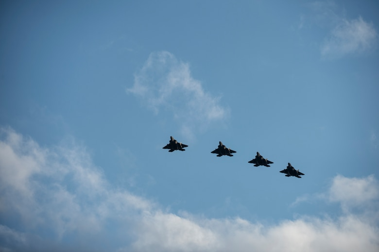 U.S. Air Force F-22 Raptor fighter aircraft pilots assigned to the 95th Fighter Squadron at Tyndall Air Force Base, Fla., fly in formation Aug. 28, 2015, over Spangdahlem Air Base, Germany. This is the first training deployment of the F-22 Raptor in the U.S. European Command theater. The U.S. values the shared commitment and close cooperation with NATO allies on countering a range of regional and global threats. (U.S. Air Force photo by Staff Sgt. Christopher Ruano/Released)