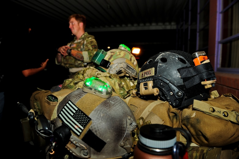 Tactical gear belonging to the 48th Rescue Squadron is displayed during a Meet and Greet event at Rincon High School, Tucson, Ariz., Aug. 26, 2015. Organizations from Davis-Monthan Air Force Base provided many types of equipment for attendees to interact with, to include a security forces battering ram trainer and an advanced medical patient simulator. (U.S. Air Force photo by Airman 1st Class Chris Drzazgowski/Released)