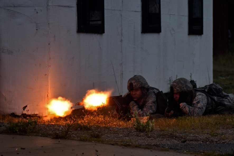 U.S. Air Force Airman 1st Class Brice Edstrom and Senior Airman Jacob Boseker, with the 121st Security Forces Squadron, provide suppressive fire with an M240B machine gun during a training exercise Aug. 19, 2015 at Camp Grayling Joint Maneuver Training Center, Mich. The 121st SFS Airmen spent three days at Camp Grayling in a simulated deployed environment as a part of their annual training. (U.S. Air National Guard photo by Airman Ashley Williams/Released)