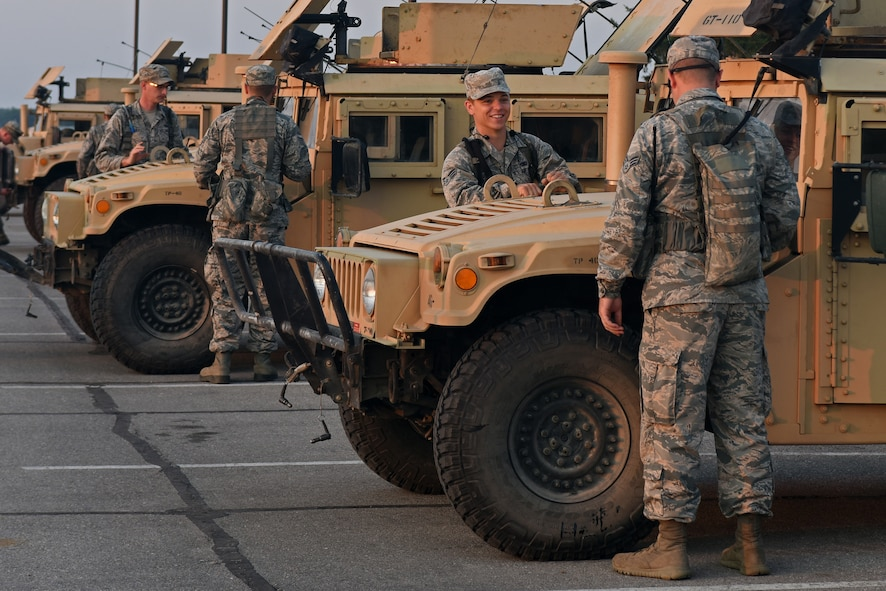 U.S. Airmen with the 121st Security Forces Squadron inspect their vehicles before departing for Camp Grayling Joint Maneuver Training Center, Mich. Aug. 17, 2015. The Airmen spent three days at Camp Grayling in a simulated deployed environment as a part of their annual training. (U.S. Air National Guard photo by Airman Ashley Williams/Released)
