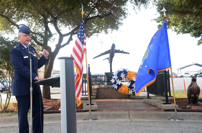 Col. David A. Scott, 433rd Airlift Wing vice commander, speaks at the25th anniversary of the Bravo-12 crash Aug. 27, 2015, at Joint Base San Antonio-Lackland, Texas. Nine 433rd AW crewmembers and four duty passengers paid the ultimate price when their C-5A Galaxy crashed on the outskirts of Ramstein Air Base, Germany during Operation Desert Shield.  (U.S. Air Force photo by Benjamin Faske) (released)