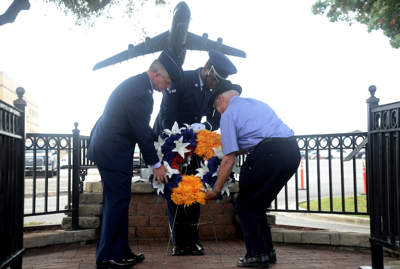 Col. David A. Scott, 433rd Airlift Wing vice commander and retired Col. Rich Ferguson, place a wreath at the BRAVO-12 Memorial Aug. 27, 2015, at Joint Base San Antonio-Lackland, Texas. This year marks the 25th Anniversary of the Bravo-12 mission where nine 433rd AW crewmembers and four duty passengers paid the ultimate price when their C-5A Galaxy crashed on the outskirts of Ramstein Air Base, Germany in support of Operation Desert Shield.  (U.S. Air Force photo by Benjamin Faske) (released)
