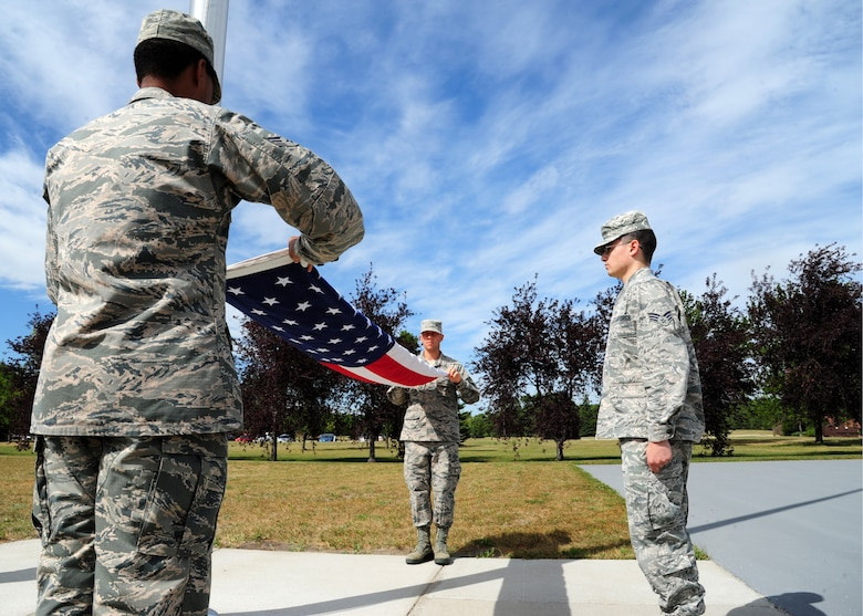 Airmen from the 319th Air Base Wing practice folding the flag August 19, 2015, on Grand Forks Air Force Base, North Dakota. The Airmen were a part of the flag detail that performed a formal retreat ceremony August 21, 2015. (U.S. Air Force photo by Airman 1st Class Ryan Sparks/Released)