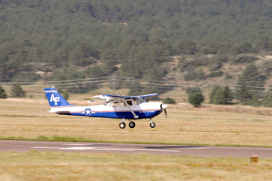 A T-41 takes off at the U.S. Air Force Academy airfield August 25, 2015. Original Tuskegee Airman Franklin Macon was riding inside in what was possibly his last ride. Macon took his first powered flight at the airfield when it was only a dirt strip. (U.S. Air Force photo/Mike Kaplan)