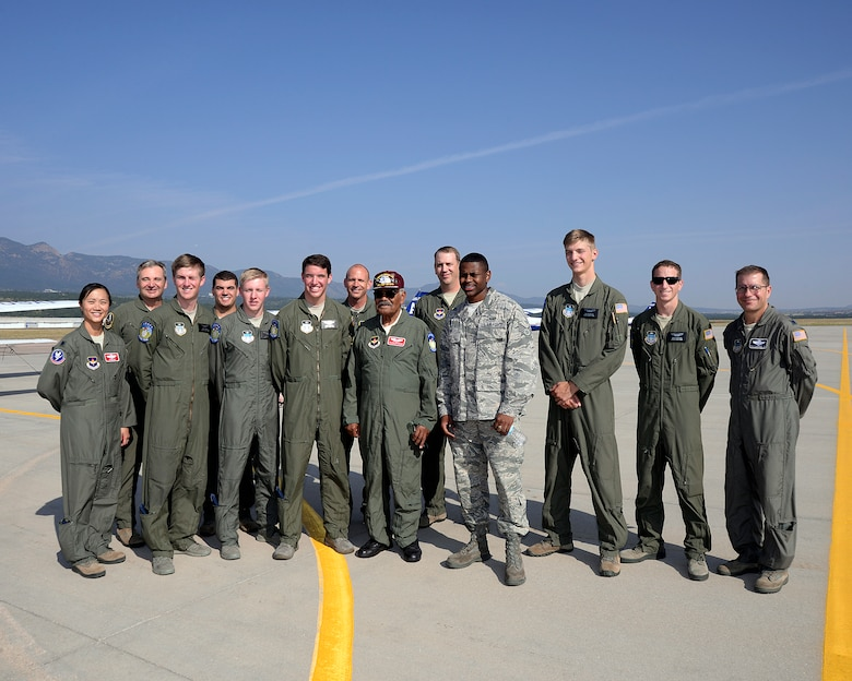 Original Tuskegee Airman Franklin Macon stands with members of the U.S. Air Force Academy cadet flying team and airfield personnel after flying in a T-41 August 25, 2015. Macon took his first powered flight at the airfield when it was only a dirt strip. (U.S. Air Force photo /Mike Kaplan)
