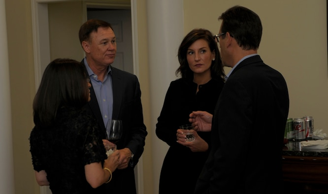 Washington Redskins Vice President of Marketing Rod Nenner, Air Force District of Washington Commander Maj. Gen. Darryl Burke and their guests Kimberlee DeWitt and Rebecca Nenner chat before dinner at the Burke residence on Joint Base Andrews, Md. August 27, 2015. The purpose of the AFDW Community Partnership Dinner is to inform, educate and raise awareness of the Air Force among distinguished civic leaders and their respective communities. (U.S. Air Force photo/Michael Martin)