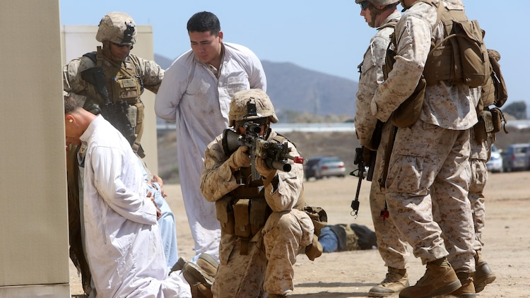 Marines with Company A, 1st Battalion, 1st Marine Regiment, 1st Marine Division, conducted a raid demonstration in a simulated town and practiced the proper procedures of apprehending detainees during an amphibious raid demonstration in conjunction with a visit from the secretary of defense, at Marine Corps Base Camp Pendleton, Calif., Aug. 27, 2015.  The Marines were transported to shore in amphibious assault vehicles with 3d Assault Amphibian Battalion, after exiting the amphibious transport dock ship USS New Orleans (LPD 18) while 3rd Light Armored Reconnaissance Battalion provided additional security.