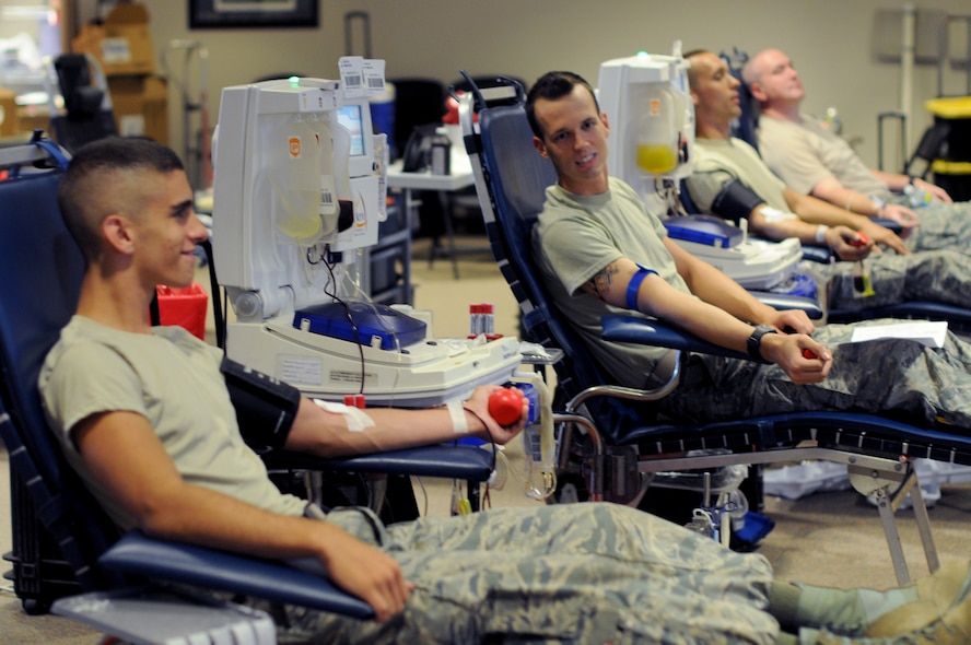 From left, U.S. Air Force Airman 1st Class Matthew Baruffi, Airman 1st Class Brandon Staines, Senior Airman Ian VanVranken and Tech. Sgt. Gary Apel, all members of the New Jersey Air National Guard's 177th Fighter Wing, relax as they give blood during a blood drive on Atlantic City Air National Guard Base, N.J., Aug. 29, 2015. The drive is sponsored by the Community Blood Council of New Jersey, and all blood donated is used in New Jersey hospitals. (U.S. Air National Guard photo by Senior Airman Shane S. Karp/Released)