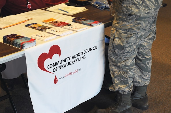 A picture of an Airman from the New Jersey Air National Guard's 177th Fighter Wing approaching the sign-in desk for a blood drive.
