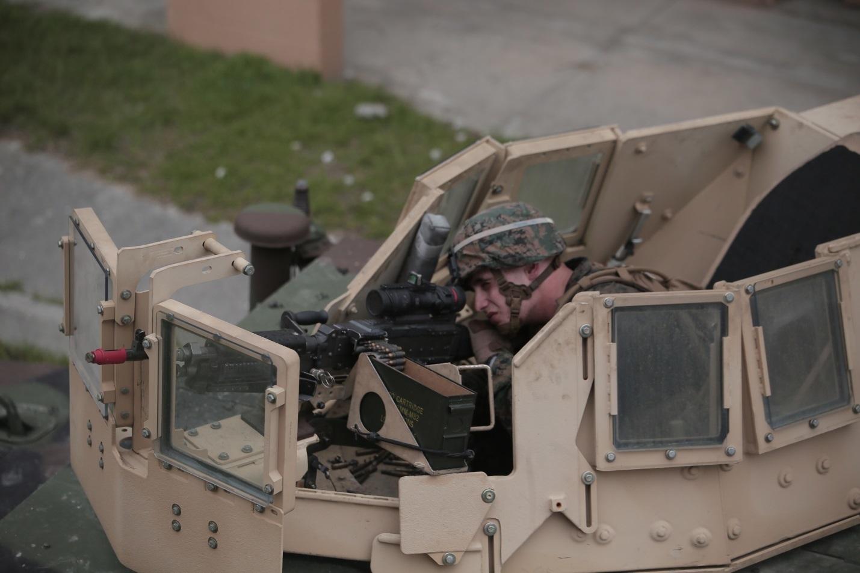 A Marine with Charlie Company, 1st Battalion, 8th Regiment, operates an M240B medium