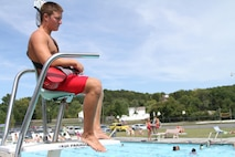 Adam Gordon, 17, a future Marine from Strasburg, Virginia, carefully observes swimmers Aug. 21, 2015, at the Strasburg Town Pool in Strasburg, Virginia. Gordon saved a 16-year old boy from drowning Aug. 15, 2015, while at the pool. He is scheduled to attend recruit training at Marine Corps Recruit Depot Parris Island, South Carolina, July, 2016. (U.S. Marine Corps photo by Sgt. Anthony J. Kirby/Released)