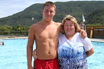 Adam Gordon, 17, a future Marine from Strasburg, Virginia, stands with his mother, Judy Atkins,  Aug. 21, 2015, at the Strasburg Town Pool in Strasburg, Virginia. Gordon saved a 16-year old boy from drowning Aug. 15, 2015, while at the pool. He is scheduled to attend recruit training at Marine Corps Recruit Depot Parris Island, South Carolina, July 2016. (U.S. Marine Corps photo by Sgt. Anthony J. Kirby/Released)