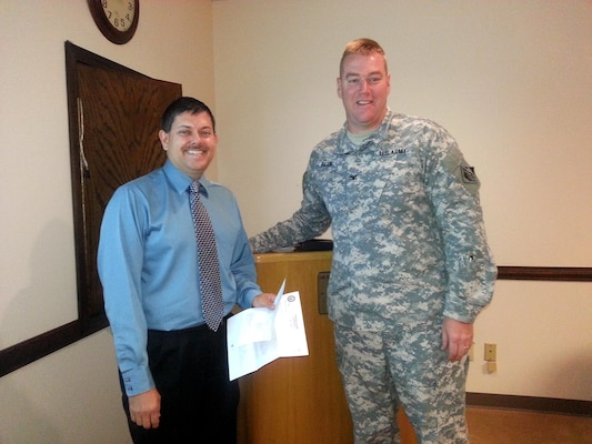 Outreach Coordinator Brandon Brummett is recognized for regional flood mitigation efforts by Louisville District Commander Col. Christopher Beck.