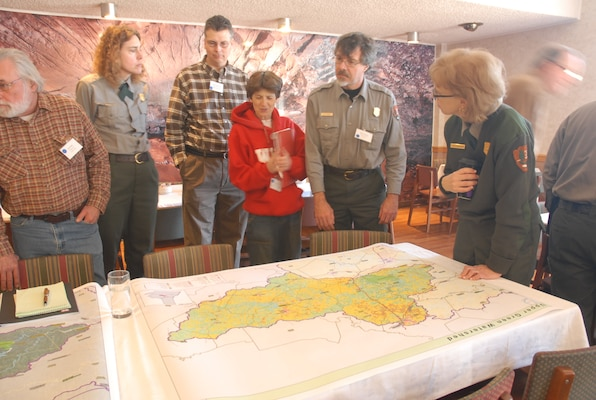 Green River Watershed, Ky., Summit attendees look at a map of the region to examine where sustainable agriculture can improve the area. `