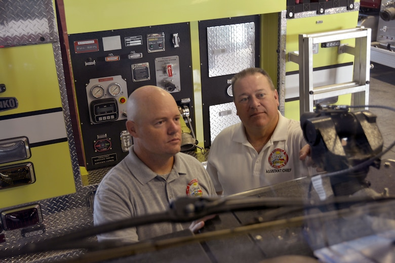"""U.S. Air Force Staff Sgt. Jeret Kinnaird, firefighter for the North Carolina Air National Guard, 145th Civil Engineer Squadron, and his supervisor, Master Sgt. Donald D. Willis, Jr., Assistant Chief of Operations for the NCANG, inspects the nozzle on a P-19 Stryker Air Firefighting Rescue truck, making sure the gallons per minute is placed on the correct setting, at Fire Station 41, Charlotte Douglas International Airport, Aug. 4, 2015. Kinnaird was recognized as Military Fire Fighter of the Year and presented """"The Chief Albert Fitzpatrick Award."""" July, 22, 2015.  (U.S. Air National Guard photo by Master Sgt. Patricia F. Moran, 145th Public Affairs/Released)"""