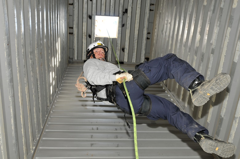 """U.S. Air Force Staff Sgt. Jeret Kinnaird, firefighter for the North Carolina Air National Guard, 145th Civil Engineer Squadron, rappels down a simulated elevator shaft during fire rescue training at the 145th Civil Engineer Regional Training Site, New London, N.C. Kinnaird, who on July 22, 2015, was presented with the """"Chief Albert Fitzpatrick Award"""" for Firefighter of the Year for 2014, is an instructor for ANG Rescue Technician I and II Courses. (U.S. Air National Guard photo by Master Sgt. Patricia F. Moran, 145th Public Affairs/Released)"""
