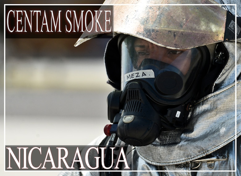"""Joshoa Moises Meza Casaya, a firefighter from Nicaragua, prepares to execute his knowledge during mobile aircraft firefighting training during the CENTAM SMOKE exercise Aug. 28, 2015, at Soto Cano Air Base, Honduras. The exercise, known as Central America Sharing Mutual Operational Knowledge and Experience, or """"CENTAM SMOKE,"""" brings together U.S. and Central American firefighters to train and improve their ability to work together. (U.S. Air Force illustration by Staff Sgt. Jessica Condit)"""