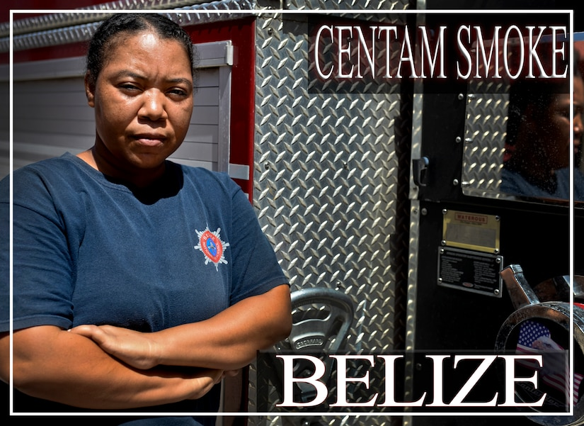 "Eldorah Dativa Chacon, a 16-year firefighter veteran from Belize, poses for a photo opportunity during the CENTAM SMOKE exercise Aug. 28, 2015, at Soto Cano Air Base, Honduras. The exercise, known as Central America Sharing Mutual Operational Knowledge and Experience, or ""CENTAM SMOKE,"" brings together U.S. and Central American firefighters to train and improve their ability to work together. (U.S. Air Force illustration by Staff Sgt. Jessica Condit)"