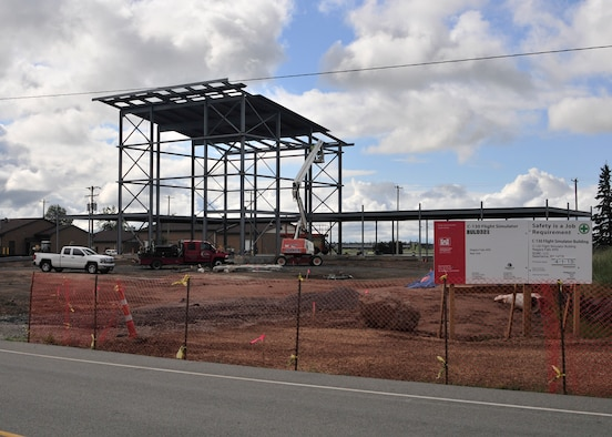 Progress! The C-130 Flight Simulator building is taking shape as construction workers attach metal sheets for the roof at the Niagara Falls Air Reserve Station N.Y. on August 27, 2015. (U.S. Air Force photo by Peter Borys)