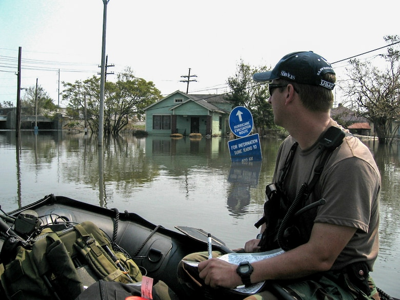A Kentucky Air National Guard combat controller searches for stranded residents during a search-and-rescue mission in New Orleans following Hurricane Katrina Sept. 5, 2005. (U.S. Air National Guard photo)