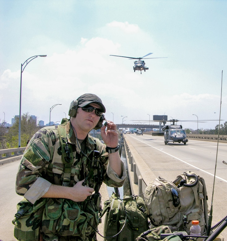 A combat controller from the Oregon Air National Guard directs helicopter flights to a make-shift landing zone along Interstate 610 in preparation for the evacuation of New Orleans residents following Hurricane Katrina Sept. 4, 2005. The mission was conducted by special tactics troops from across the Air National Guard, including 22 combat controllers and pararescuemen from Kentucky. (U.S. Air National Guard photo)
