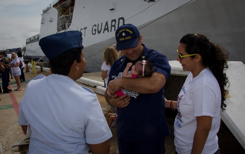 A United States Coast Guard Cutter James crew member is reunited with his wife and newborn baby daughter during the cutter's inaugural homecoming in Charleston, S.C. Aug. 28, 2015. The James is the fifth of eight planned National Security Cutters – the largest and most technologically advanced class of cutters in the Coast Guard's fleet. (U.S. Air Force photo/Staff Sgt. AJ Hyatt)