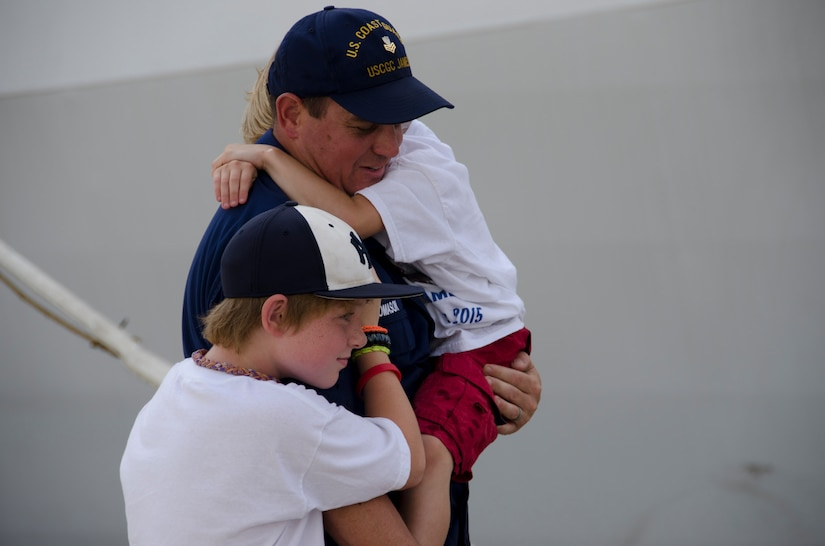 A United States Coast Guard Cutter James crew member is reunited with family members during the cutter's inaugural homecoming to Charleston, S.C. Aug. 28, 2015. The James is the fifth of eight planned National Security Cutters – the largest and most technologically advanced class of cutters in the Coast Guard's fleet. (U.S. Air Force photo/Staff Sgt. AJ Hyatt)