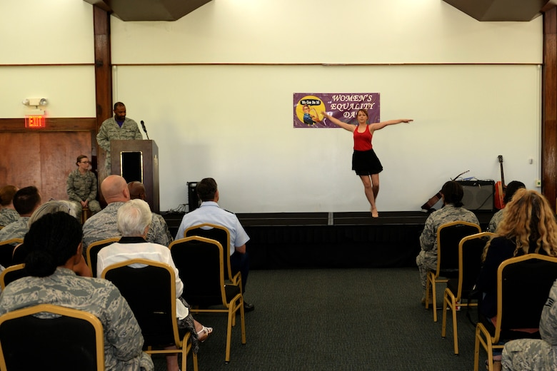 Airman 1st Class Mattison Krouse, 36th Munitions Squadron, performs an interpretive dance during the Women's Equality Day social Aug. 28, 2015, at Andersen Air Force Base, Guam. This year's Women's Equality Day marked the 95th anniversary of the 19th Amendment, which gave women the right to vote in 1920. (U.S. Air Force photo by Airman 1st Class Alexa Ann Henderson/Released)
