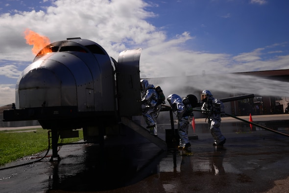 Two firefighters from the Songtan fire station followed by Staff Sgt. Michael White, 51st Civil Engineer Squadron crew chief, enter a training aircraft to perform a fire extinguishing exercise Aug 26, 2015, at Osan Air Base, Republic of Korea. Firefighters from the 51st CES recently hosted a fire-training event and invited the local firefighters as well as firefighters from the Republic of Korea air force to participate. (U. S. Air Force photo by Staff Sgt. Benjamin Sutton)