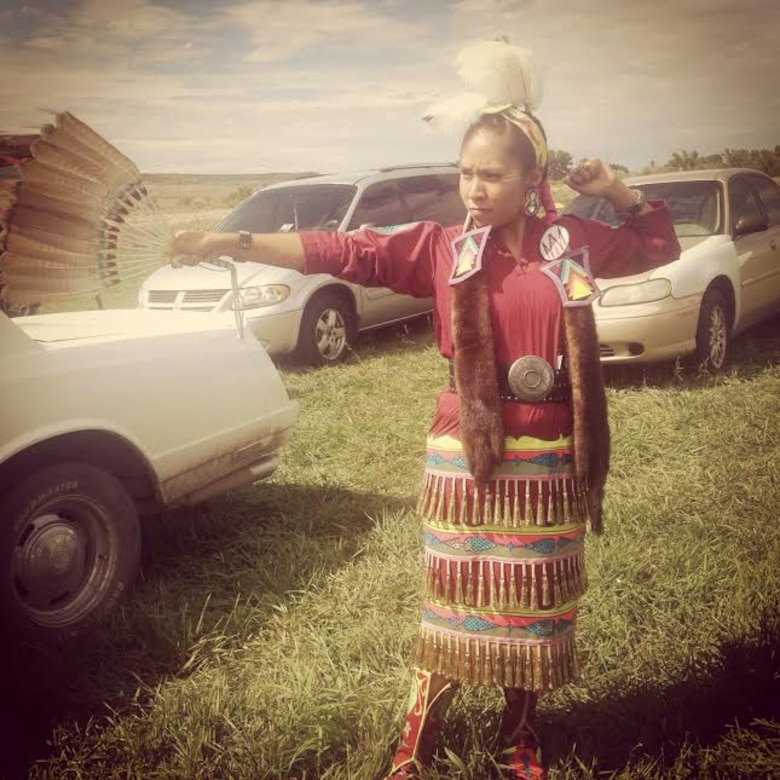 Letyraial Cunningham poses in the traditional Navajo clothing during a Native American social gathering in August at Towaoc, Colo. (Courtesy photo)