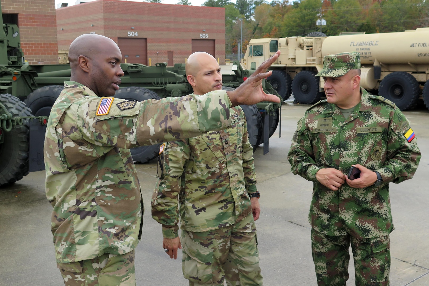 U.S. Army 1st Lt. Omar Benjamin (left), with the South Carolina Army National Guard's Combined Support Maintenance Shop, answers questions from Colombian Army Lt. Col. Hernando Rodriguez through Army National Guard Sgt. 1st Class Alexander Lombana, Nov. 19, 2015. The South Carolina National Guard held a Subject Matter Expert Exchange with its Partner Nation Nov. 15-21, 2015. While in South Carolina, the five Colombian officers toured various sites and met with their National Guard counterparts seeing firsthand the areas affected by the floods, and how the Guard responded working alongside civilian first responders and state and local emergency management. Since its launch in 2012, when the South Carolina National Guard introduced its State Partnership Program (SPP) with the Republic of Colombia, S.C., has focused on establishing long-term relationships where Colombia and South Carolina can promote mutual interests and build lasting capabilities. In the past year the South Carolina National Guard has held 26 engagements with its partner nation. (U.S. Air Force photo by 1st Lt. Stephen D. Hudson)