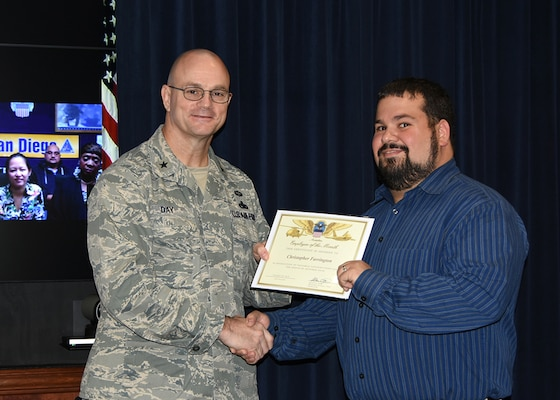 Defense Logistics Agency Aviation Commander Air Force Brig. Gen. Allan Day congratulates Christopher Farrington on being selected as DLA Aviation's October Employee of the Month during a ceremony Nov. 25, 2015. Farrington serves as a project manager for the Industrial Plant Equipment Services Division of DLA Aviation's Engineering Directorate in Richmond, Virginia.