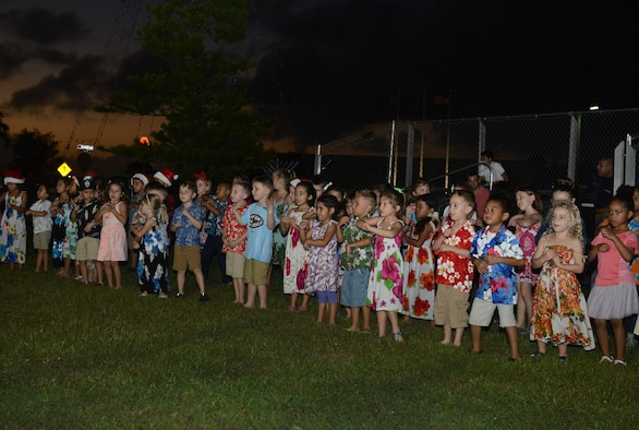 Andersen Elementary School children sing holiday songs at the tree lighting ceremony Dec. 1, 2015, at Andersen Air Force Base, Guam. Approximately 300 people attended the ceremony in celebration of the holiday season. (U.S. Air Force photo by Airman 1st Class Arielle Vasquez/Released)
