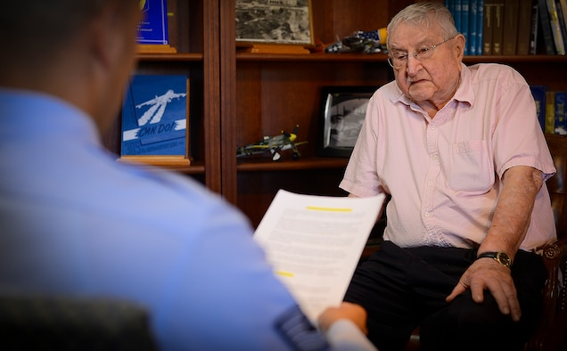 Technical Sgt. Brandon Shapiro interviews retired Col. Harry Buzzett, a WWII, Korean War and Vietnam War veteran, Nov. 30, 2015 at MacDill Air Force Base, Fla. Buzzett is a WestPoint graduate who fought the Germans, Chinese, and Vietcong on the front lines of battle. (U.S. Air Force photo by Airman 1st Class Brad Tipton)