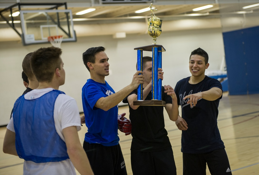 The 5th Contracting Squadron team celebrates their victory after the intramural indoor soccer championship at Minot Air Force Base, N.D., Nov. 24, 2015. After coming down to penalty kicks, 5th CONS beat the 5th Medical Group team. (U.S. Air Force photo/Senior Airman Apryl Hall)